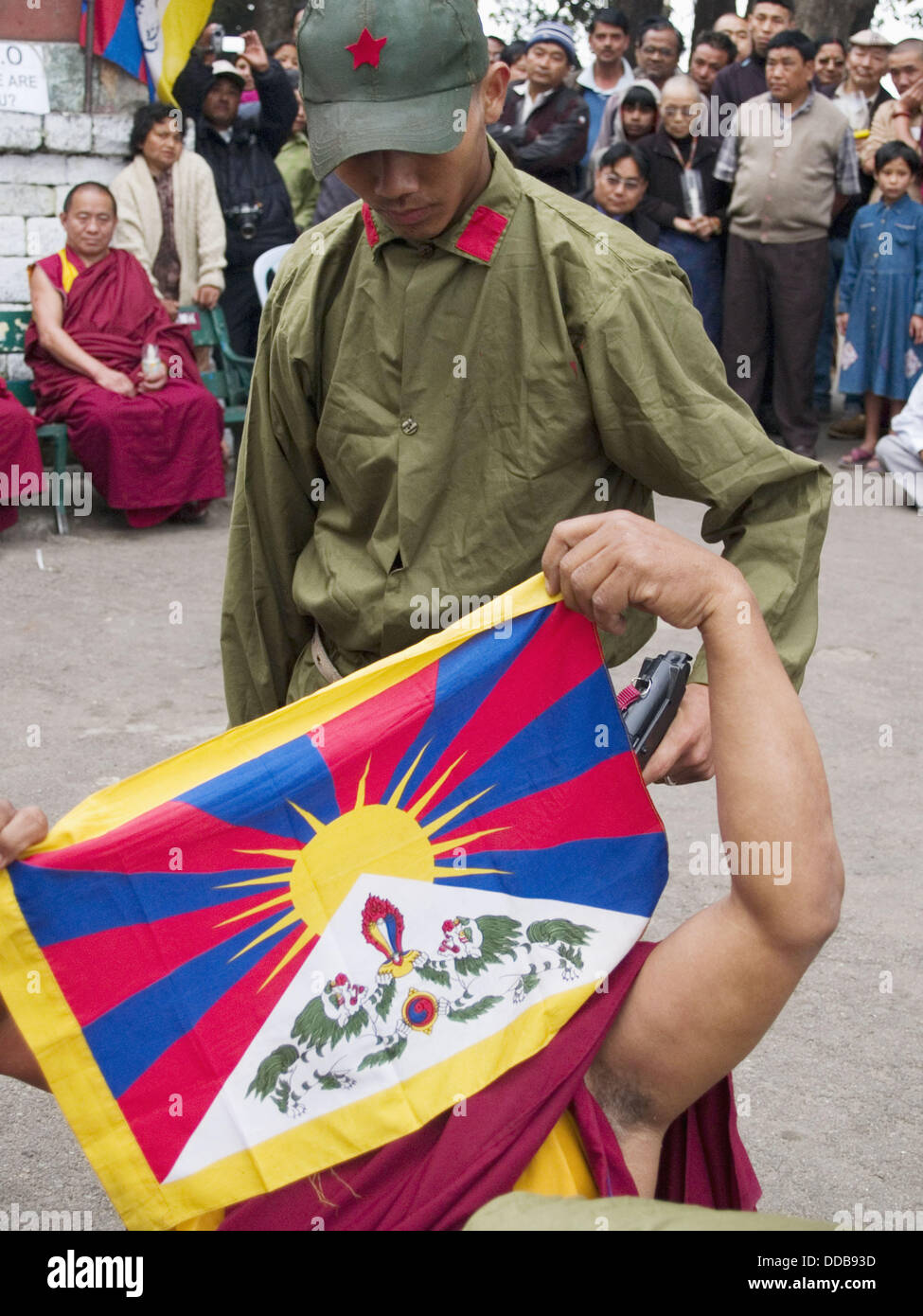 Tibetans mocking Chinese brutality at rally in Darjeeling India - Stock Image