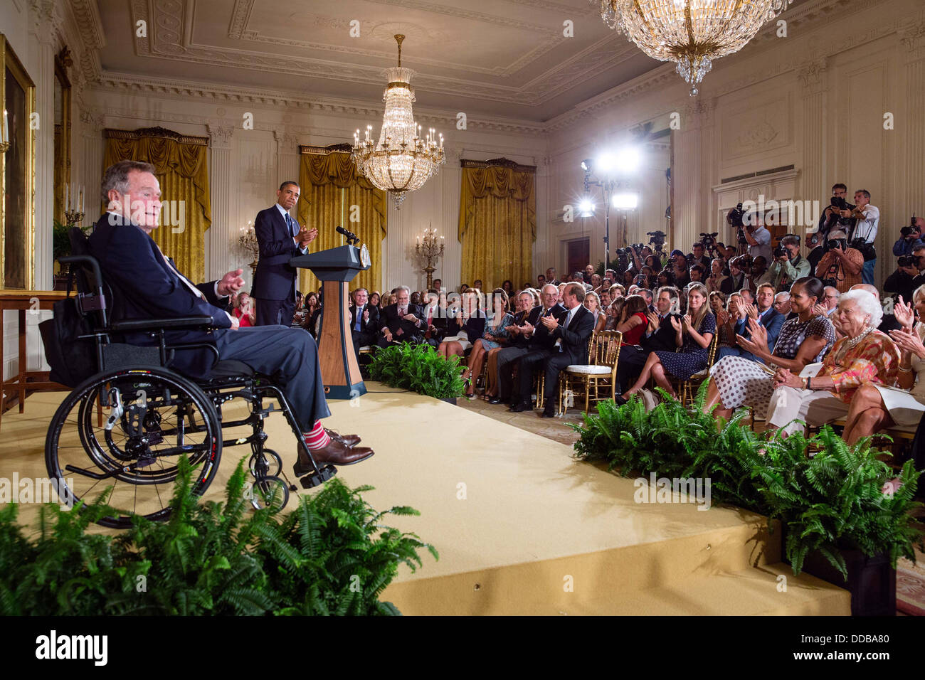 US President Barack Obama with former President George H. W. Bush deliver remarks before they present the 5,000th - Stock Image