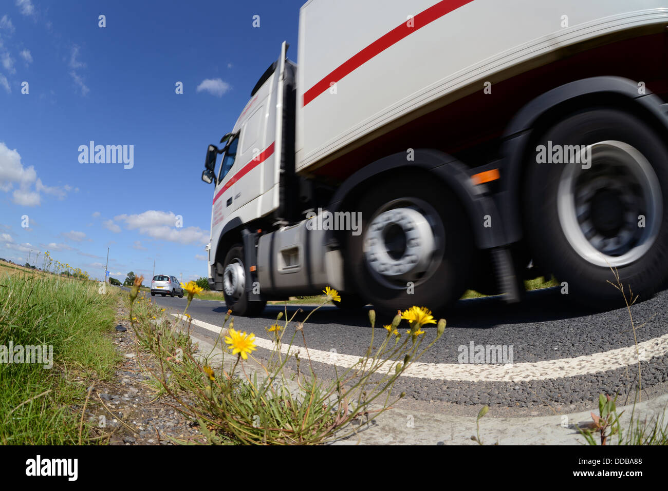 lorry angle view of lorry traveling along country road near Leeds Yorkshire United Kingdom - Stock Image