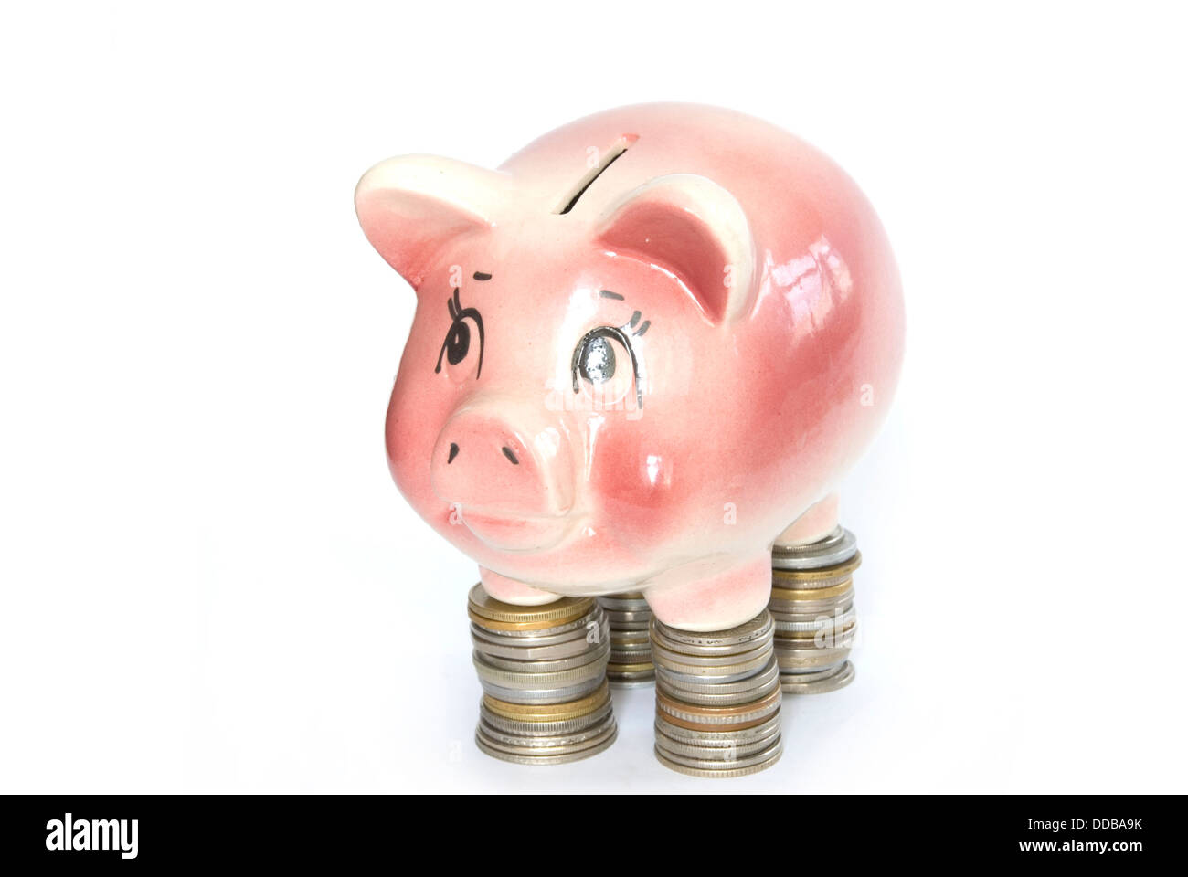 piggy bank on coins Stock Photo