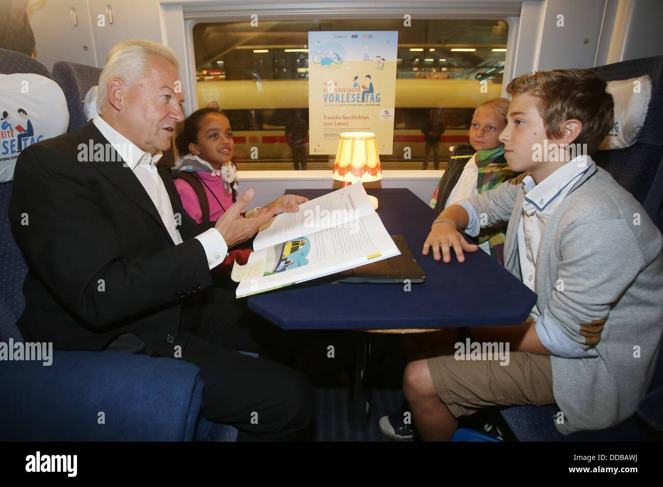Deutsche Bahn railway company chairman Ruediger Grube reads a book to pupils from the St. Ursula elementary school Stock Photo