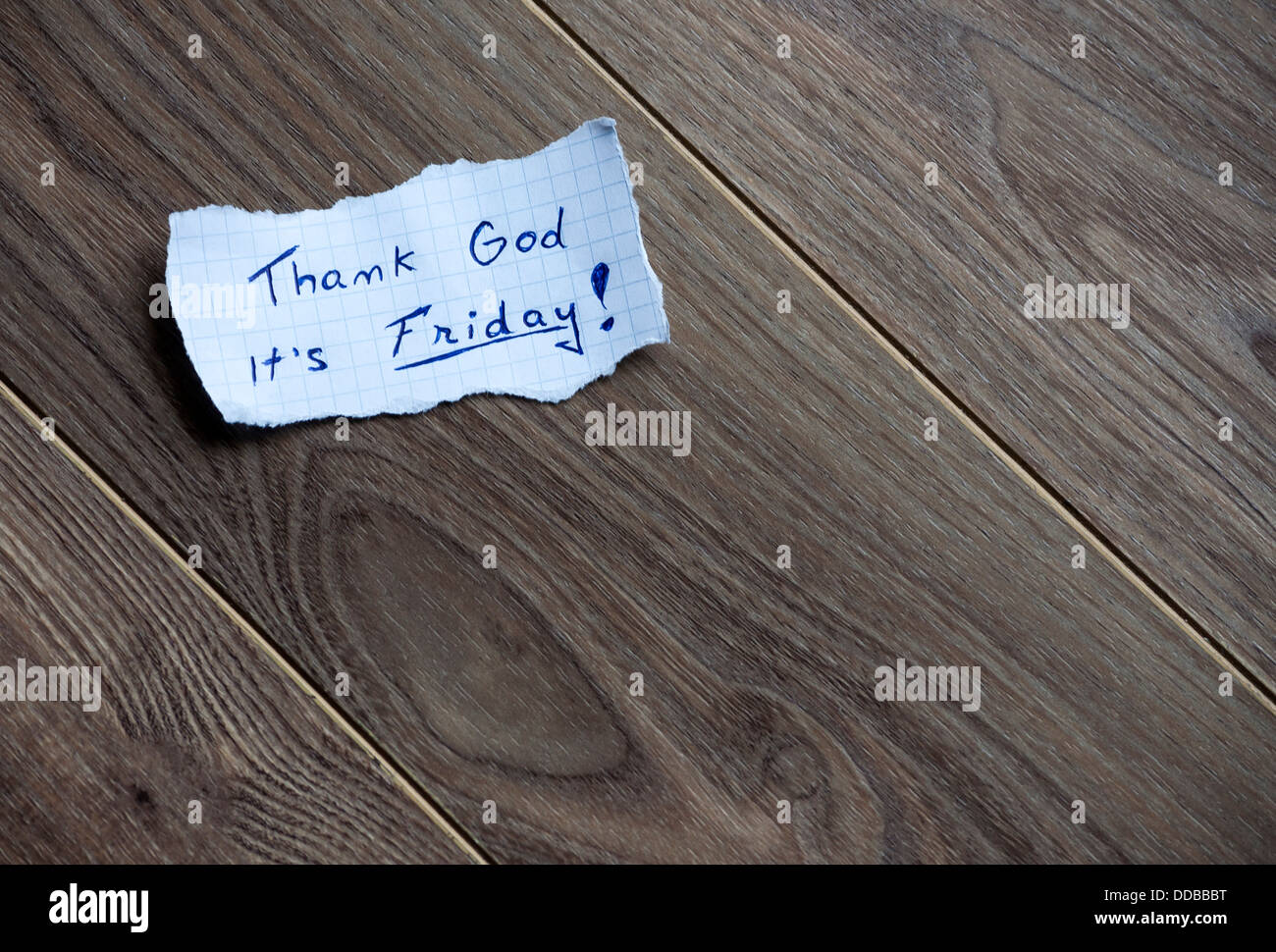 Friday message,written on piece of paper, on a wood background. Space for your text. - Stock Image