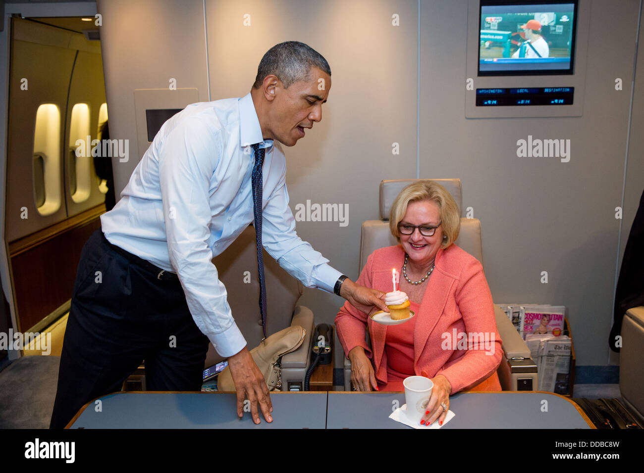 US President Barack Obama presents Senator Claire McCaskill with a birthday cupcake aboard Air Force One July 24, - Stock Image
