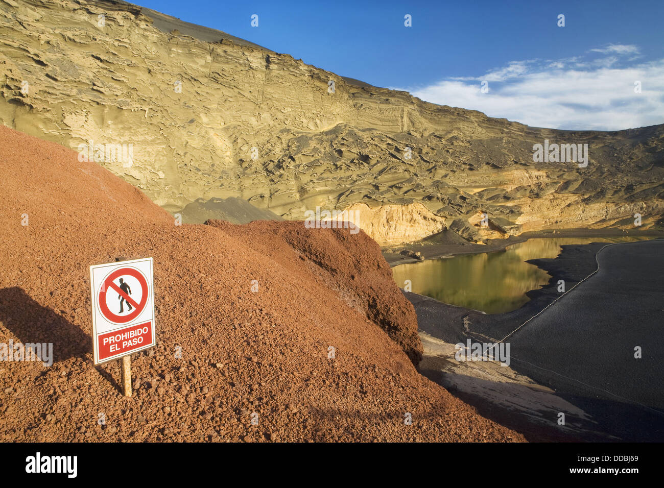 Layers of volcanic ash, corresponding to a volcanic crater in the coast  Lake Green in El Golfo  Yaiza  Lanzarote, - Stock Image