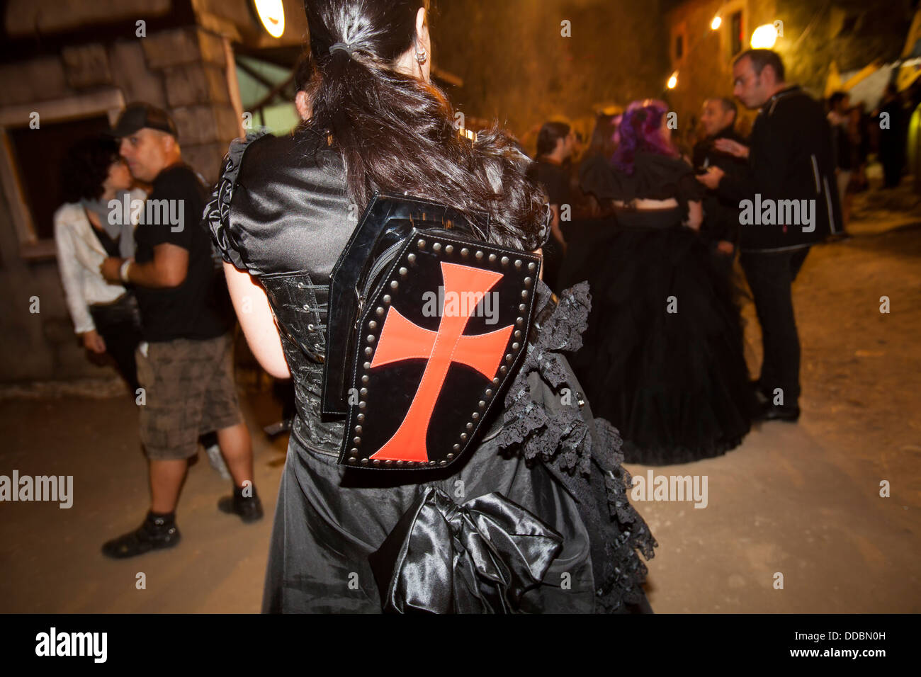 Girl with backpack coffin at Entremuralhas 2013, a gothic festival dedicated to the goth subculture in Leiria, Portugal. - Stock Image