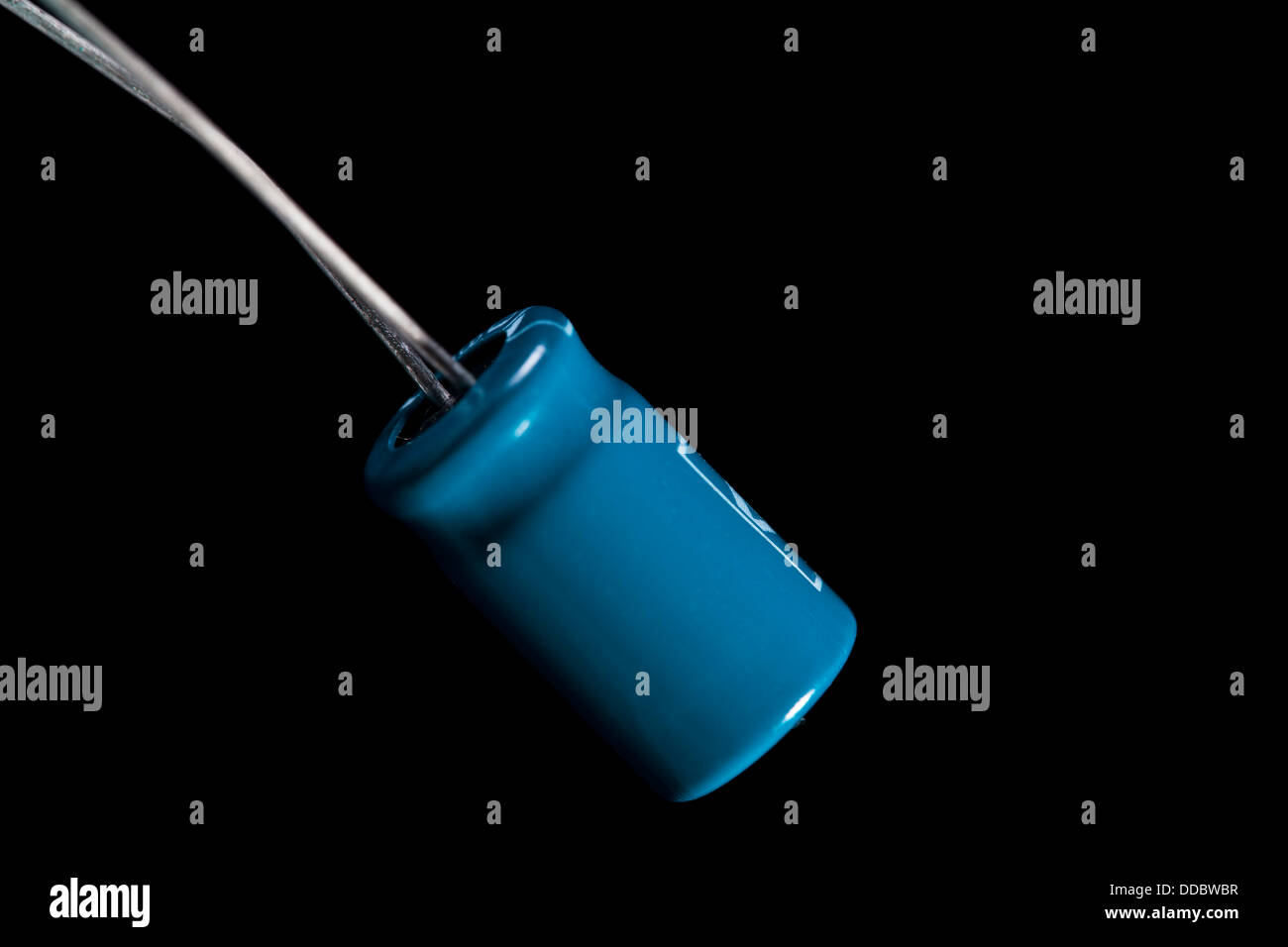 Photo of a resistor against a black background - Stock Image