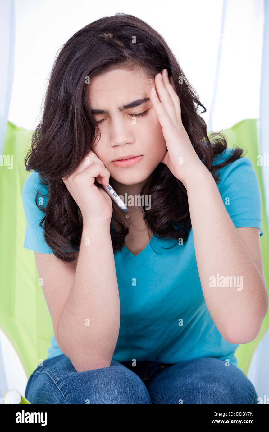 Teen girl or young woman having stressful phone conversation - Stock Image