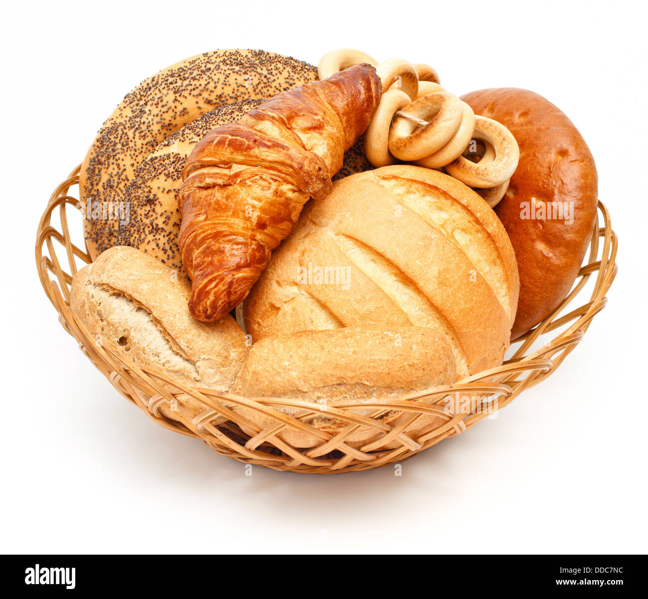 Arrangement of bread in basket on white background - Stock Image