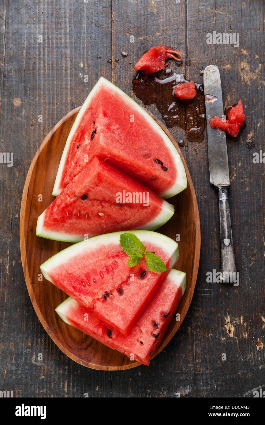 Watermelon slices on wooden background - Stock Image