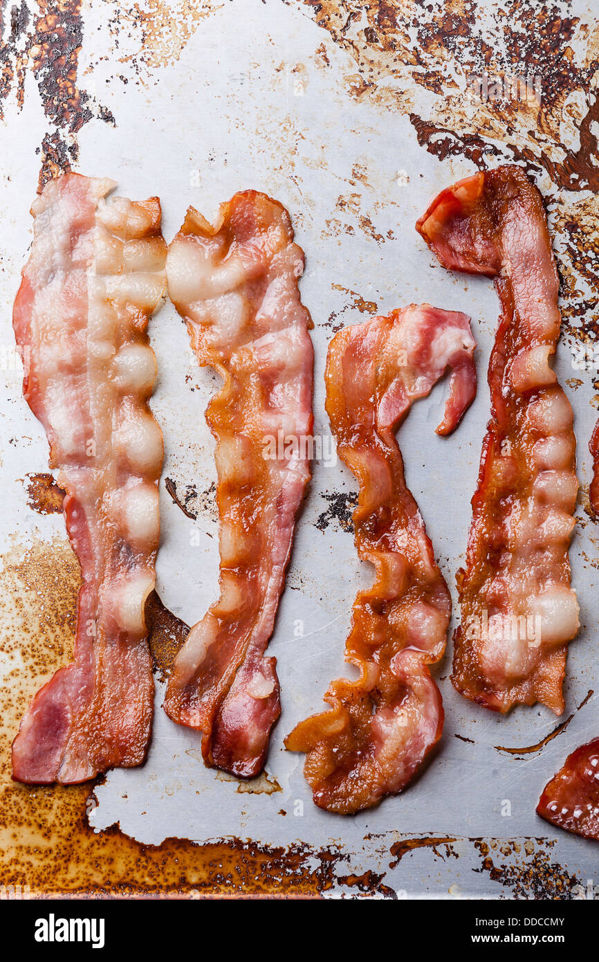 Crispy fried bacon background - Stock Image