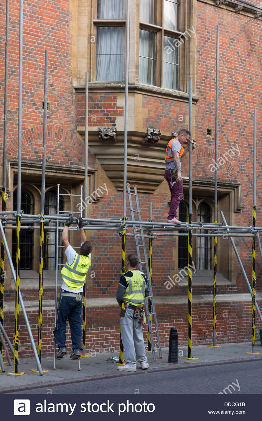 Scaffolders installing scaffolding in Cambridge - Stock Image