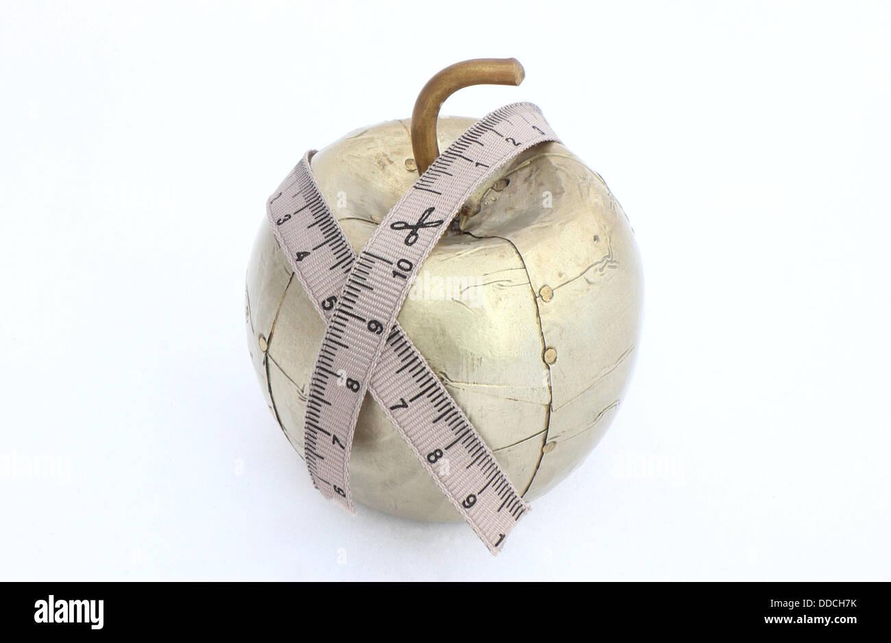 Metallic apple on diet - Stock Image
