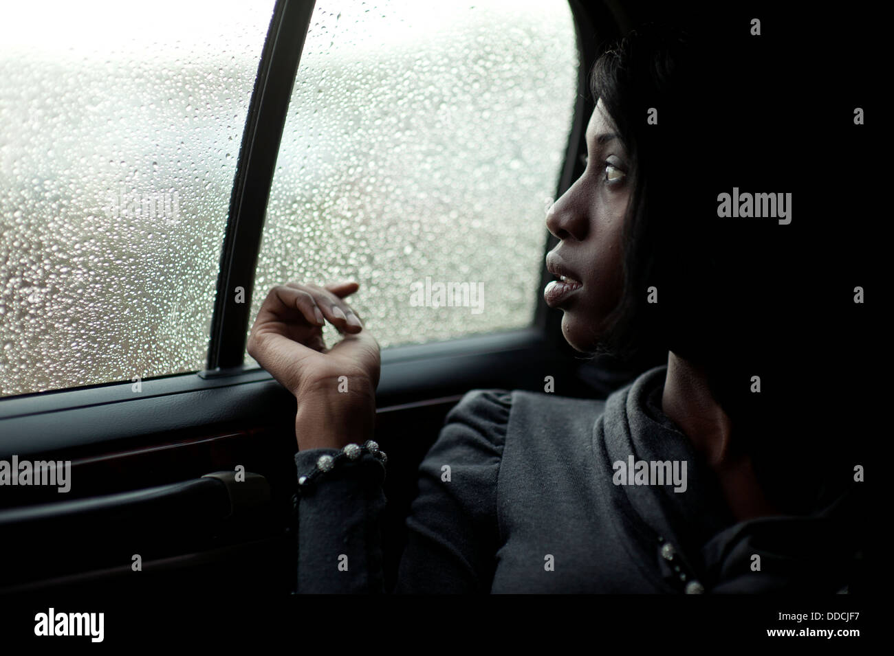 African American Girl Sitting On The Back Seat In A Lincoln Town Car