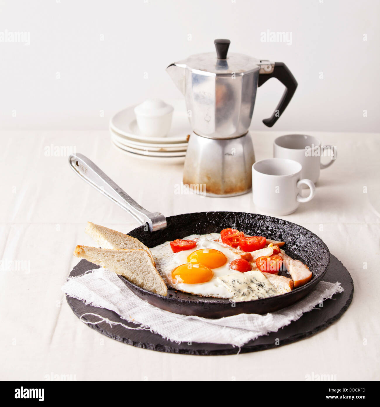 Ham and eggs breakfast with toast and coffee - Stock Image