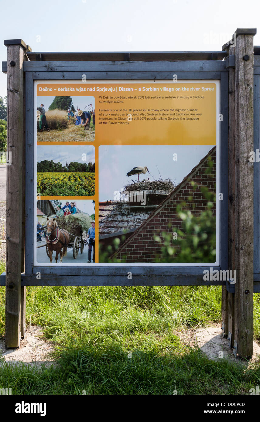 Sign giving information about the stork population in the Sorbian village of Nissen, Spreewald, Germany - Stock Image