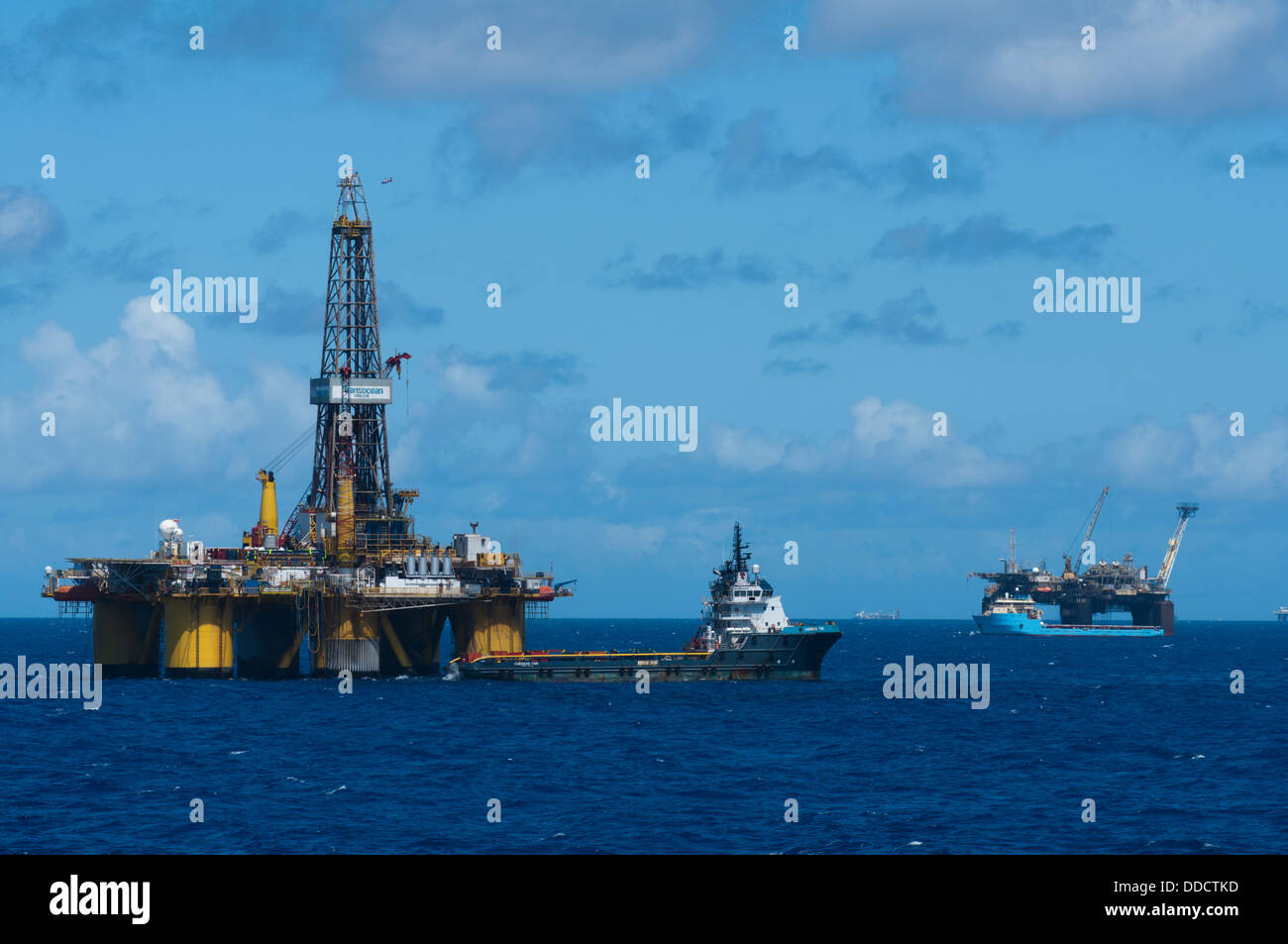 ss 50 oil drilling rig offshore Campos basin, Rio de Janeiro, Brazil. working for Petrobras. Supply vessel alongside. - Stock Image