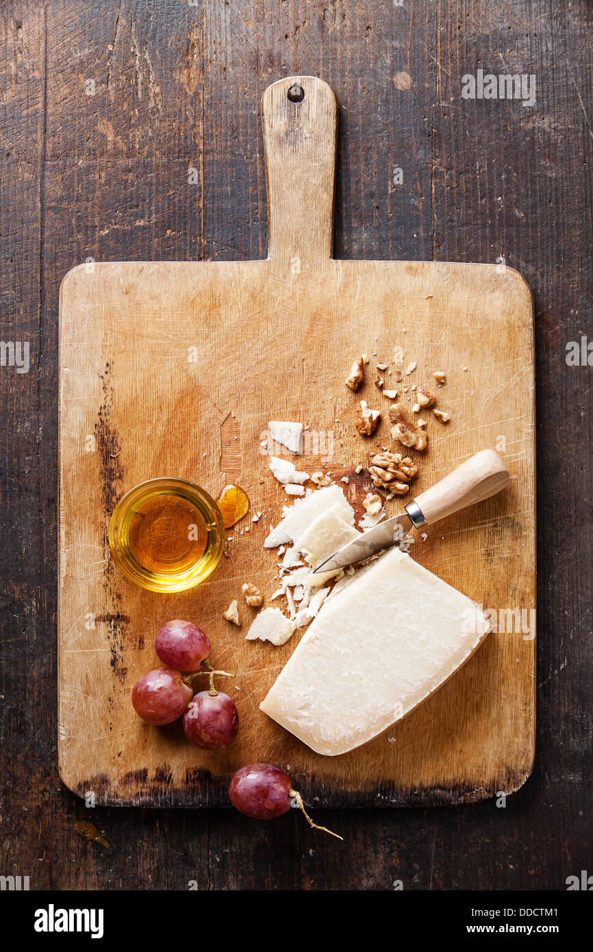 Parmesan cheese with honey, grapes and nuts - Stock Image