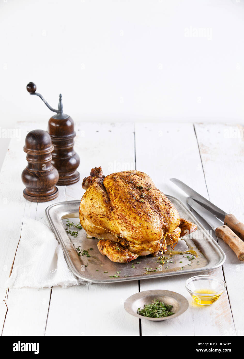 Whole roasted chicken on white wooden background Stock Photo