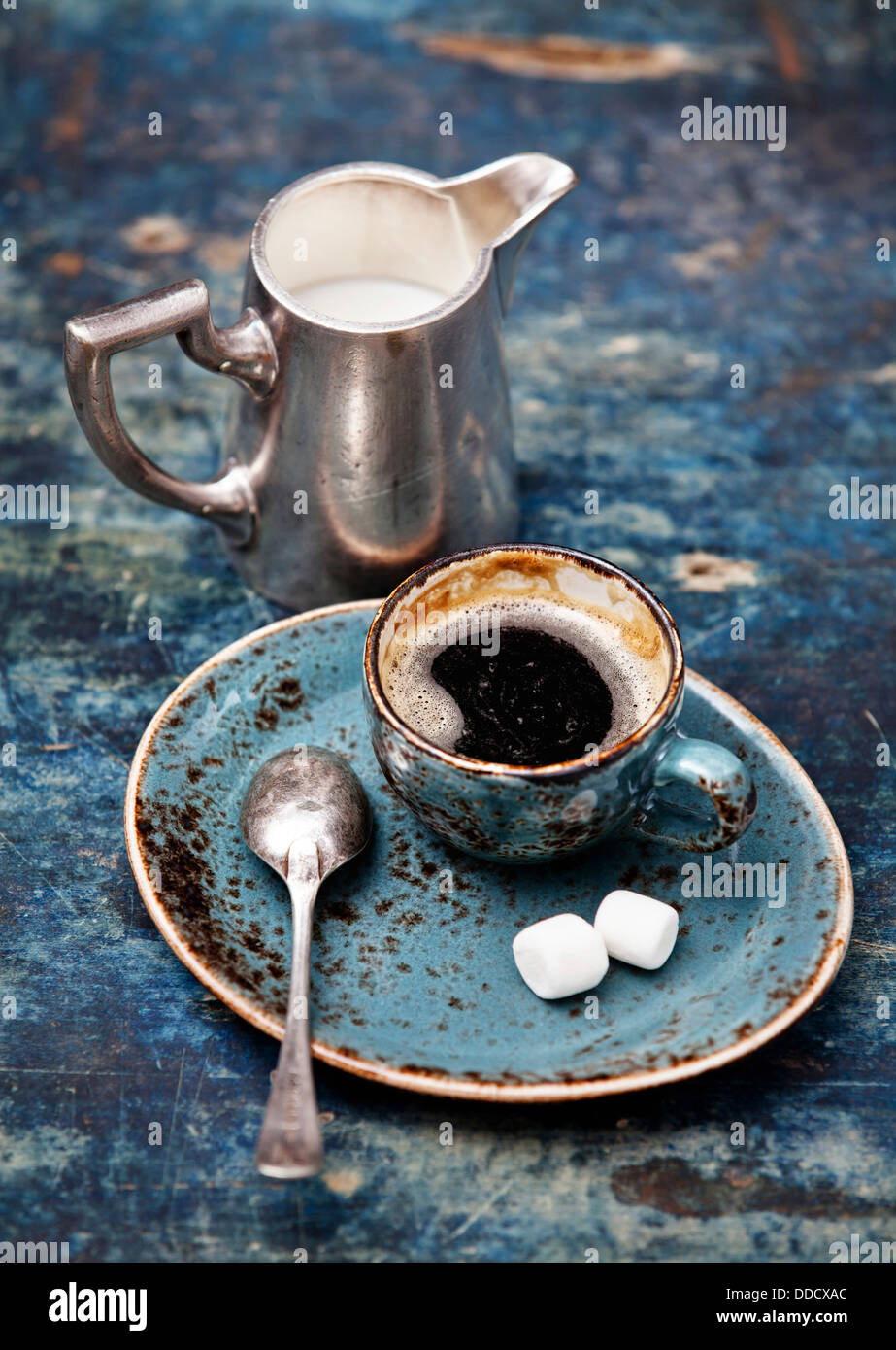 Coffee cup on blue background - Stock Image