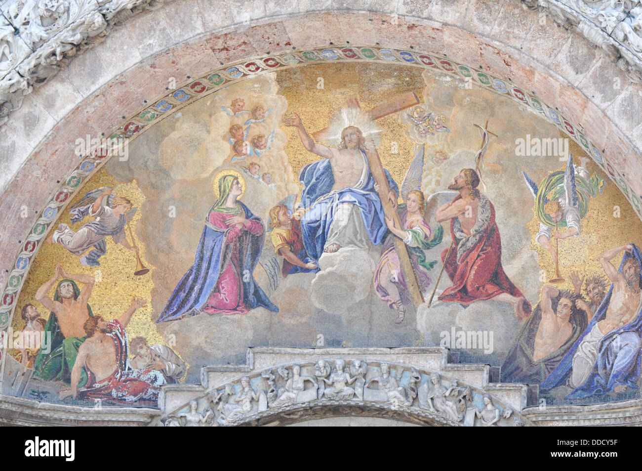 Religious painting on the front door of St. Marco Church, Venice Italy - Stock Image