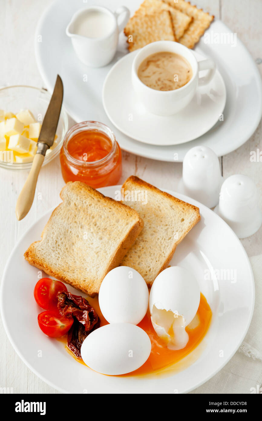 Traditional breakfast eggs with coffee - Stock Image