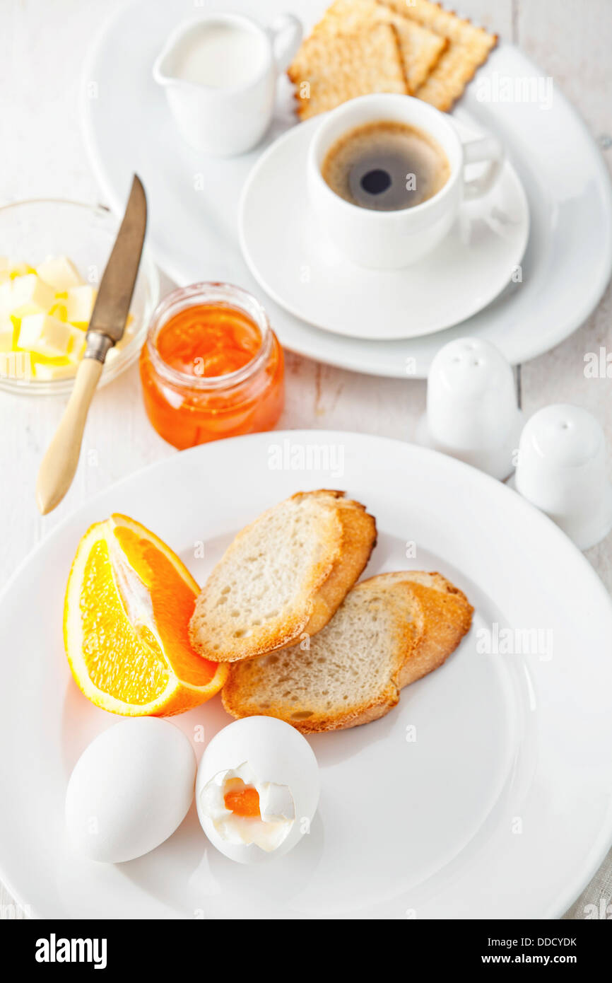 Eggs, toasts and coffee for breakfast - Stock Image
