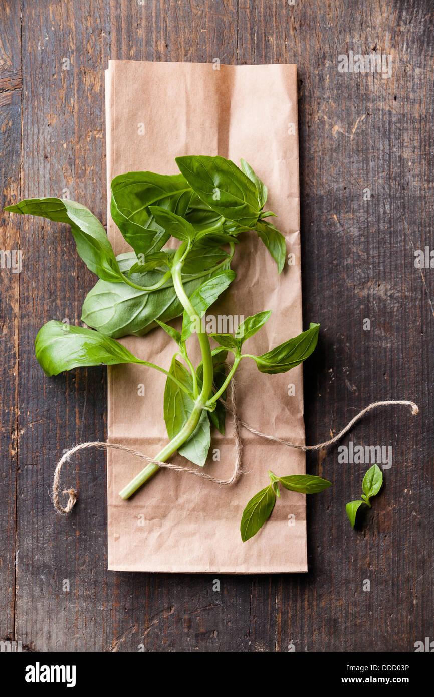 Green basil leaf on textured background - Stock Image