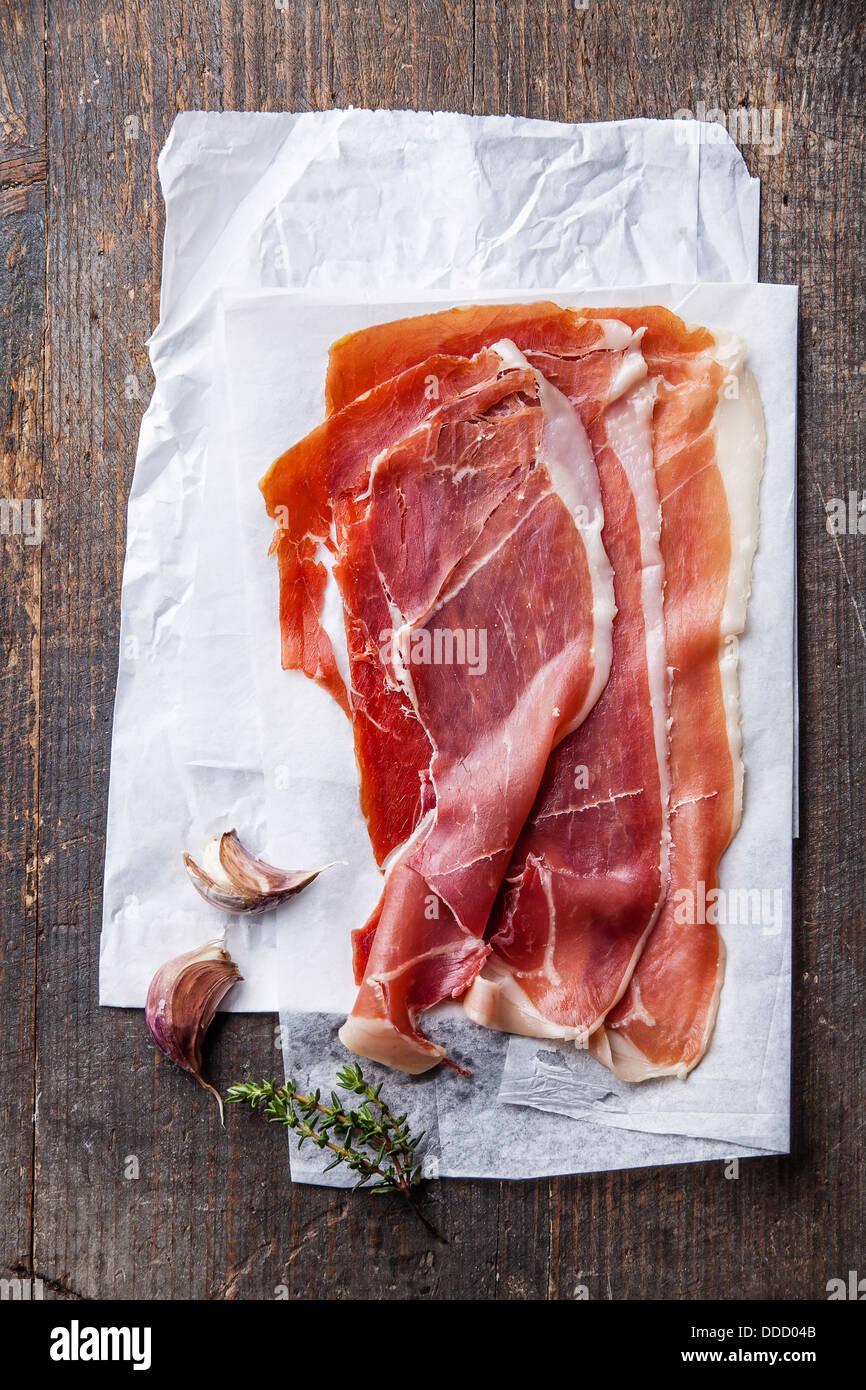 Ham slices on wooden background Stock Photo