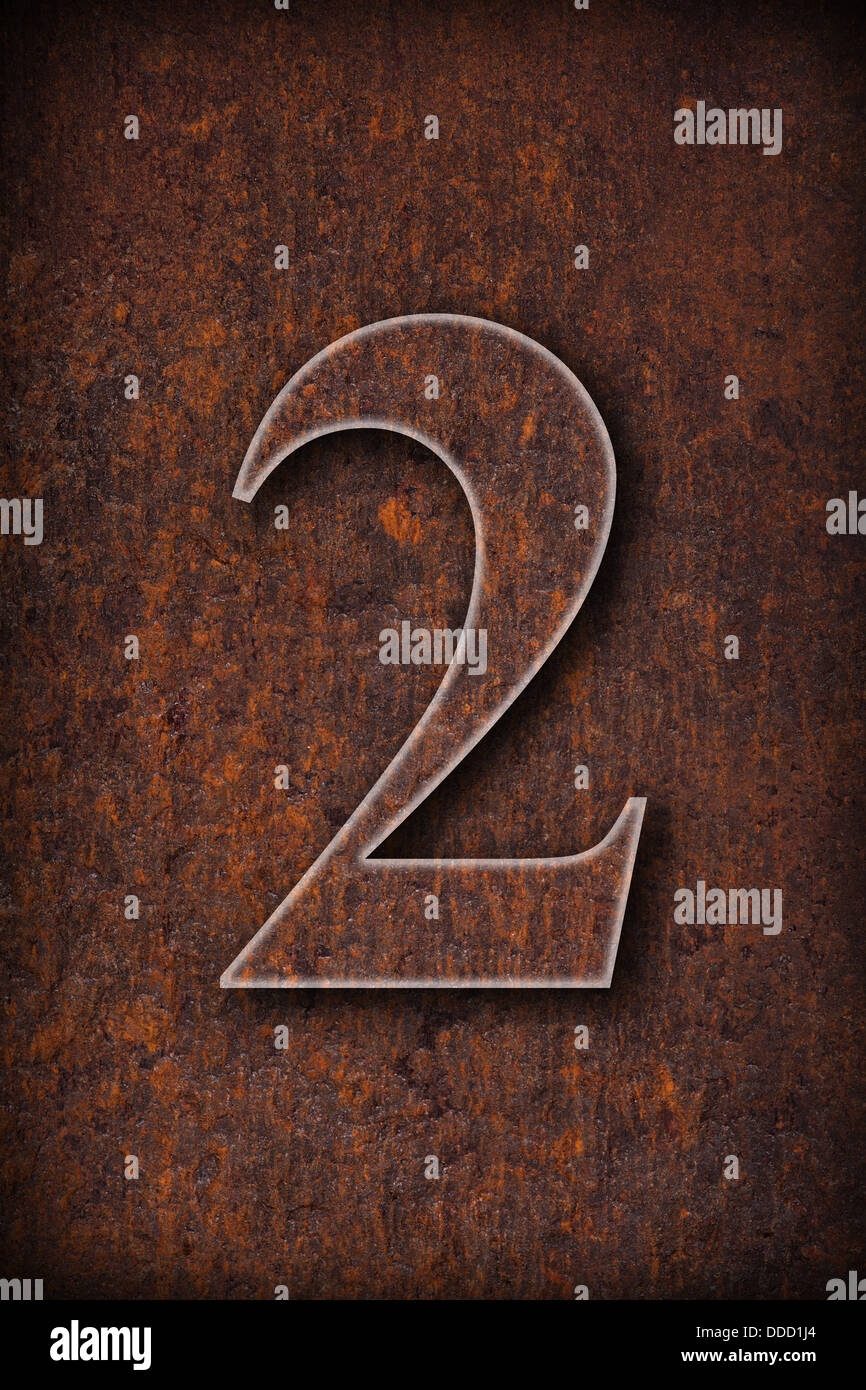 number two on rusty iron brown background - Stock Image