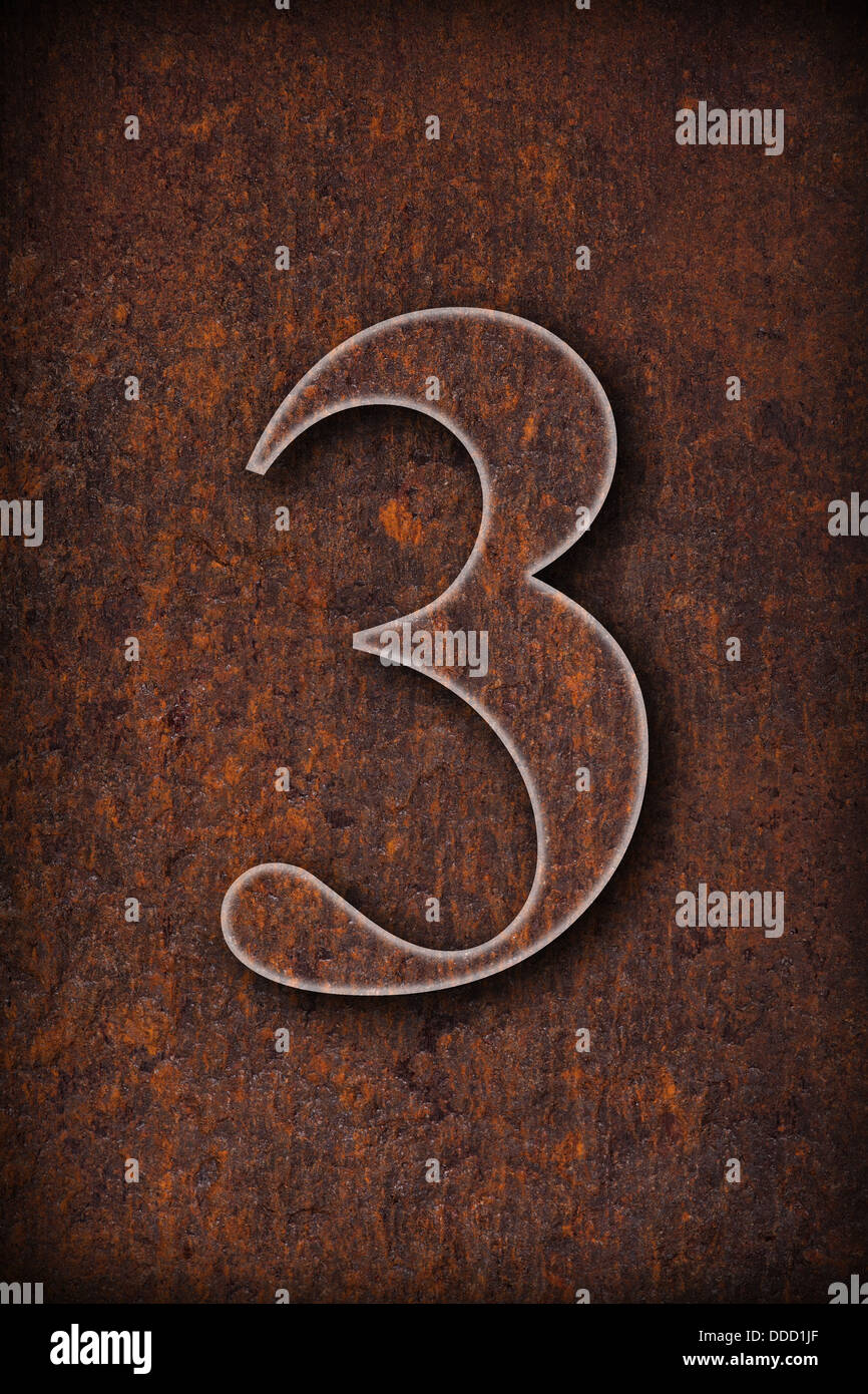 three number on rusty iron brown background - Stock Image