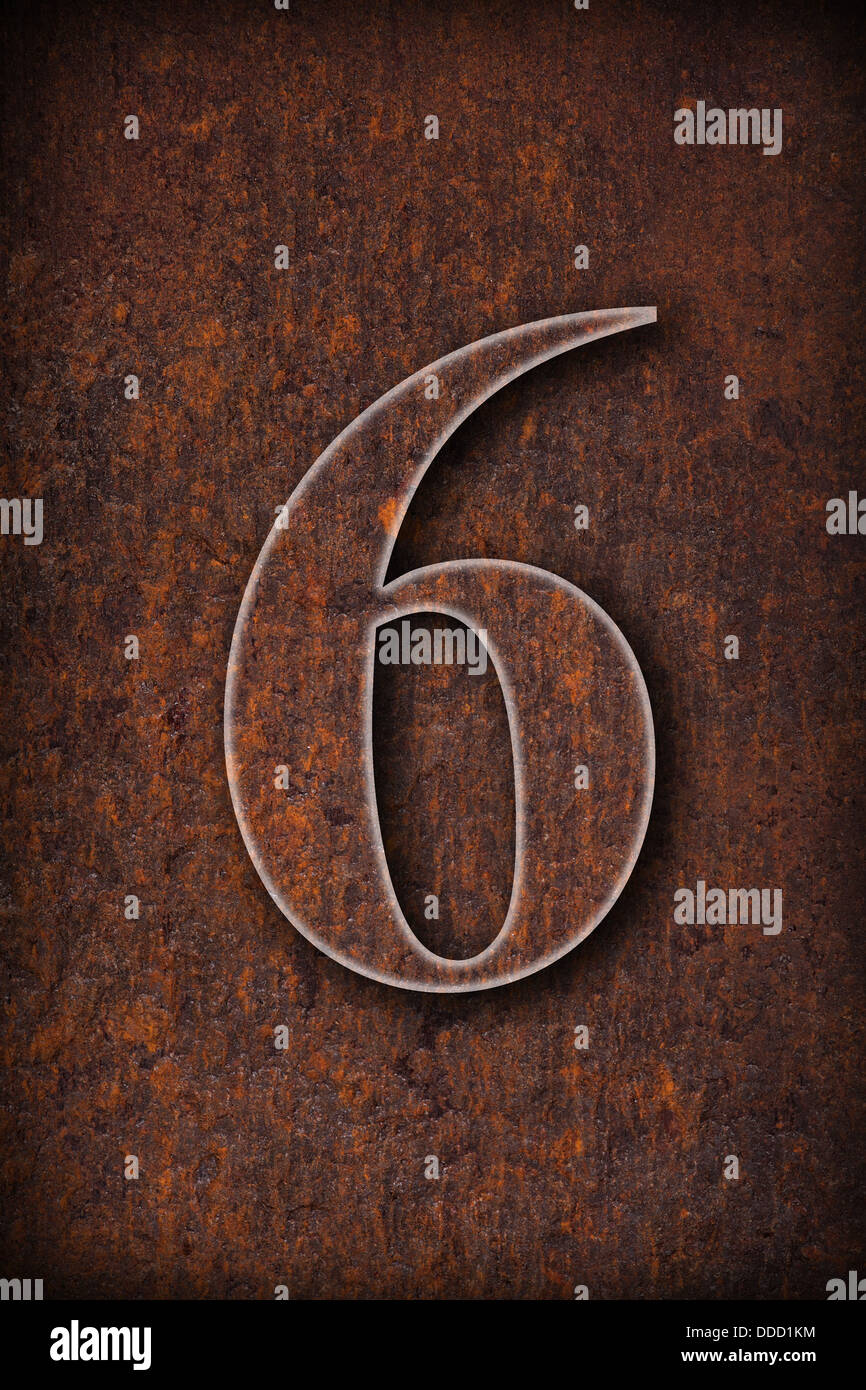 number six on rusty iron brown background - Stock Image