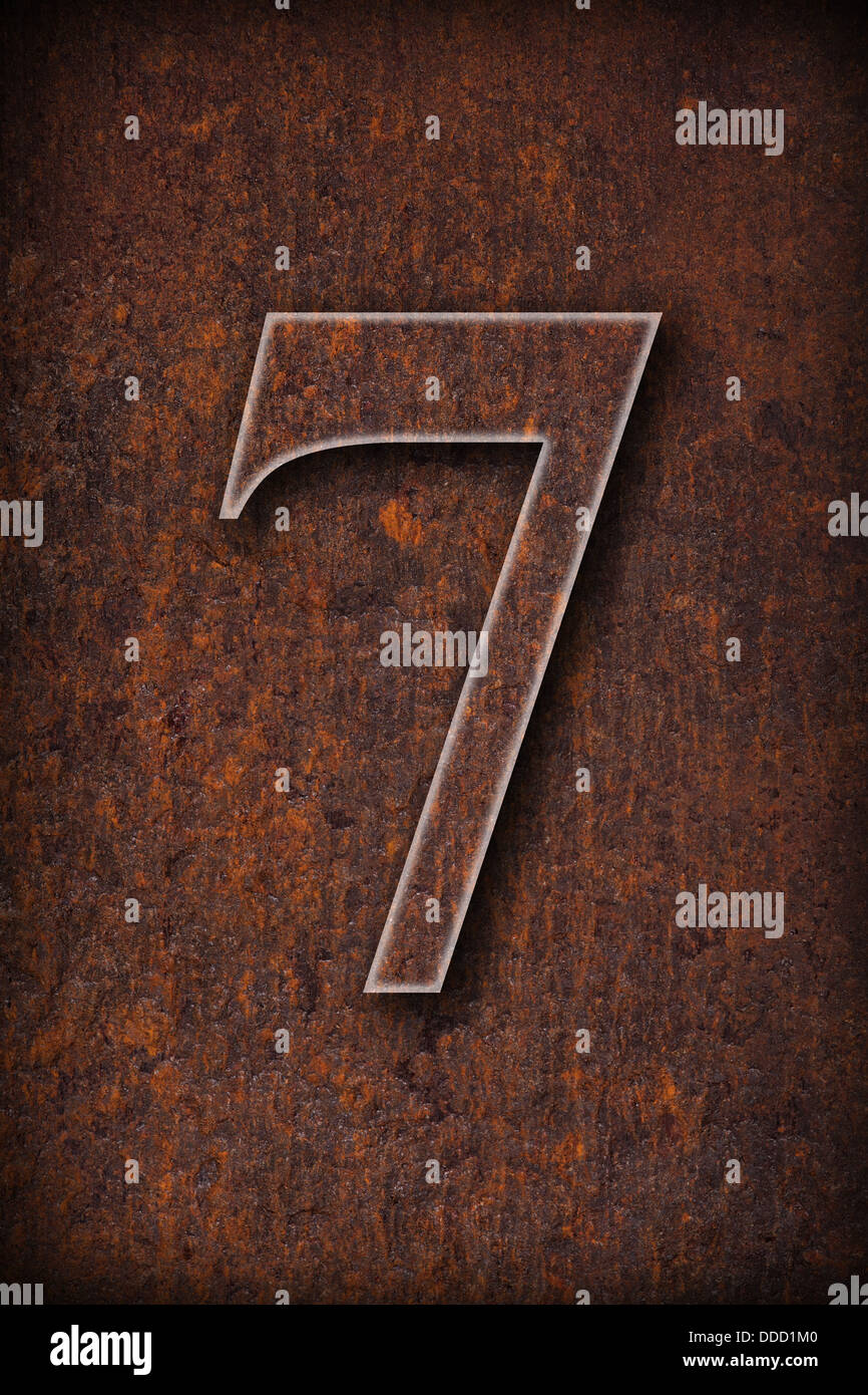 number seven on rusty iron brown background - Stock Image