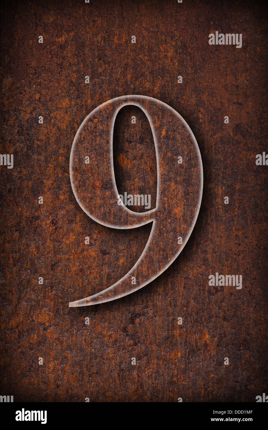 number nine on rusty iron brown background - Stock Image