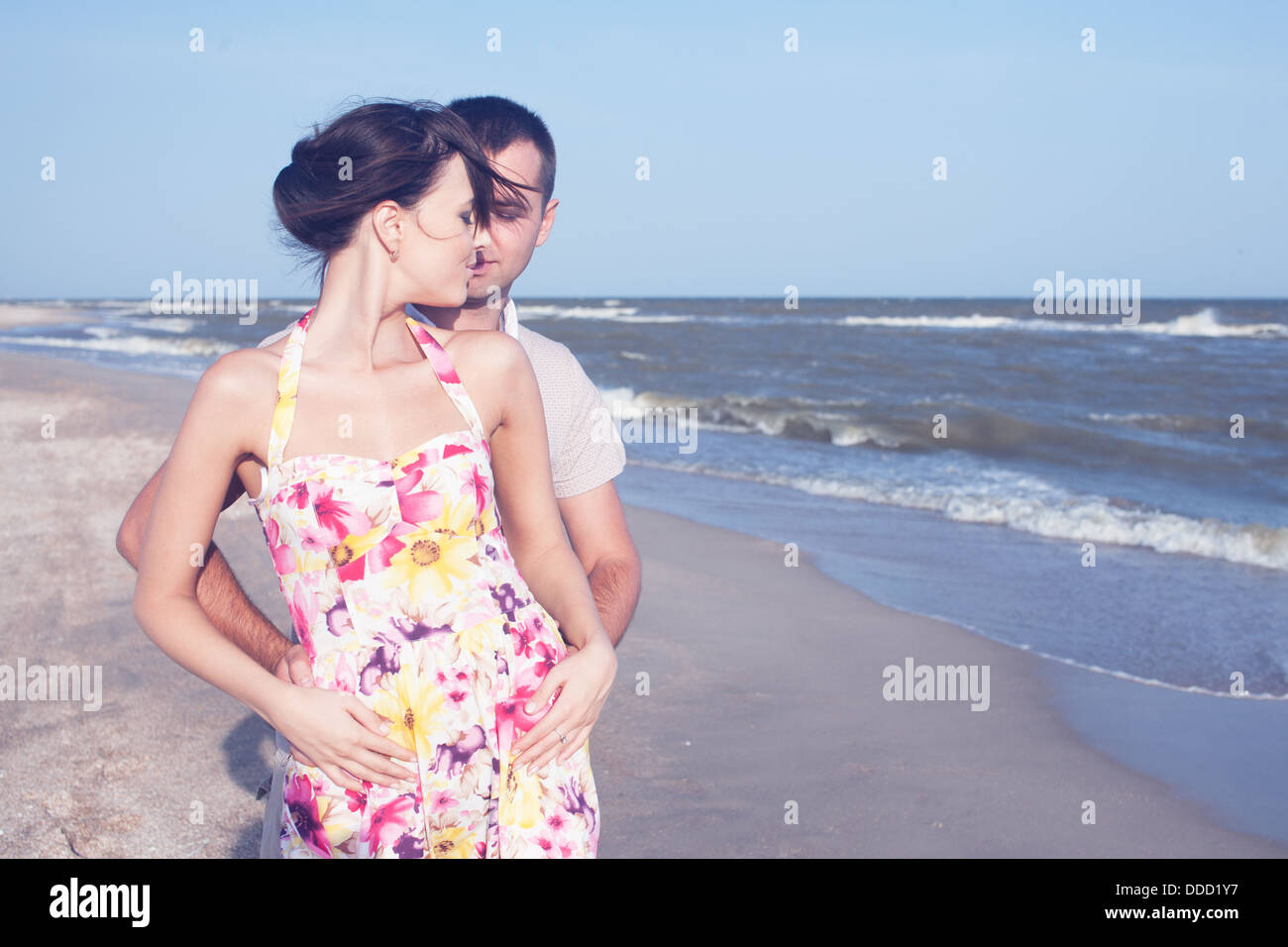 Passionate heterosexual couple on the seashore. Outdoors - Stock Image
