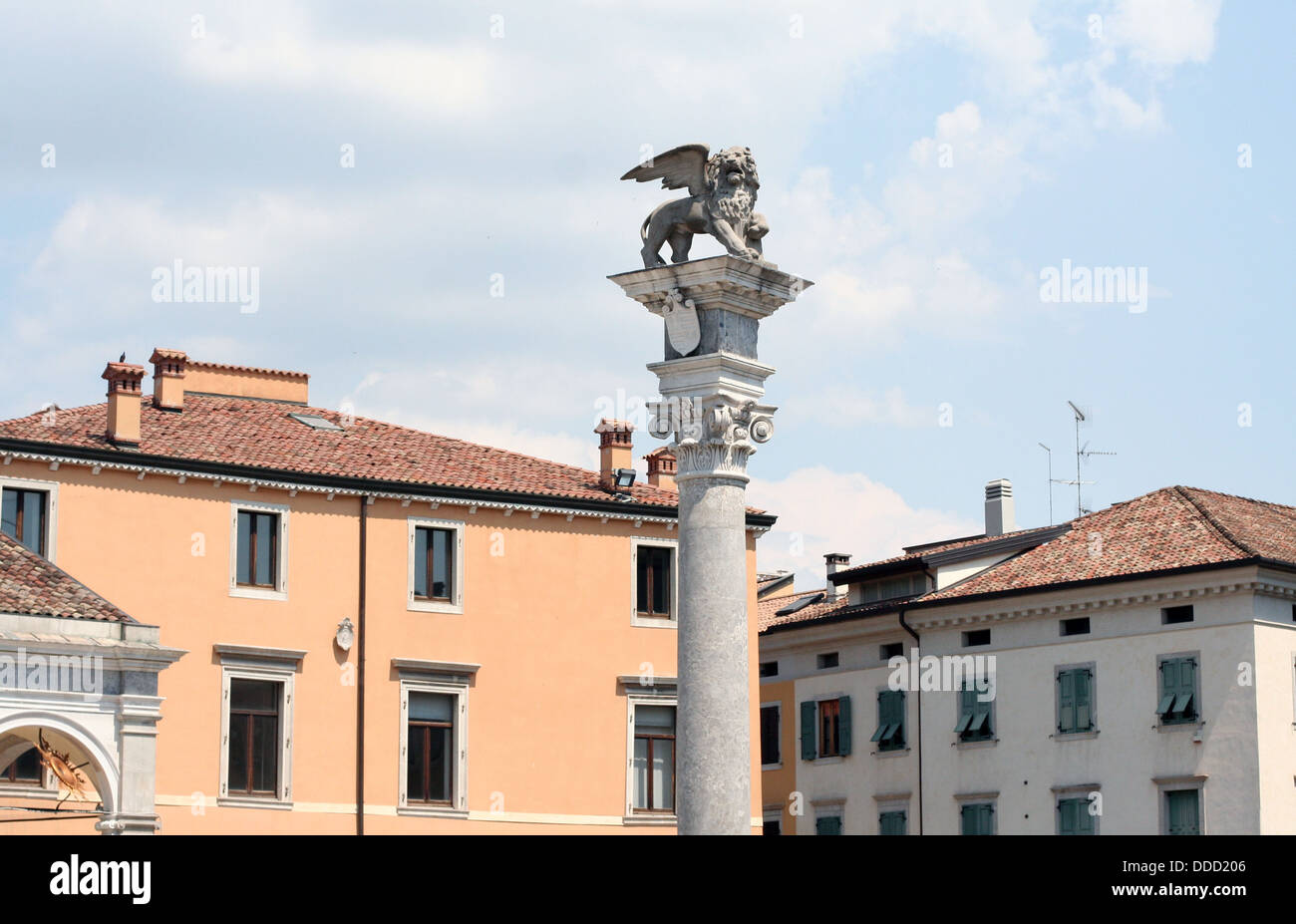 Pillar with winged lion on piazza della Liberta in Udine - Stock Image