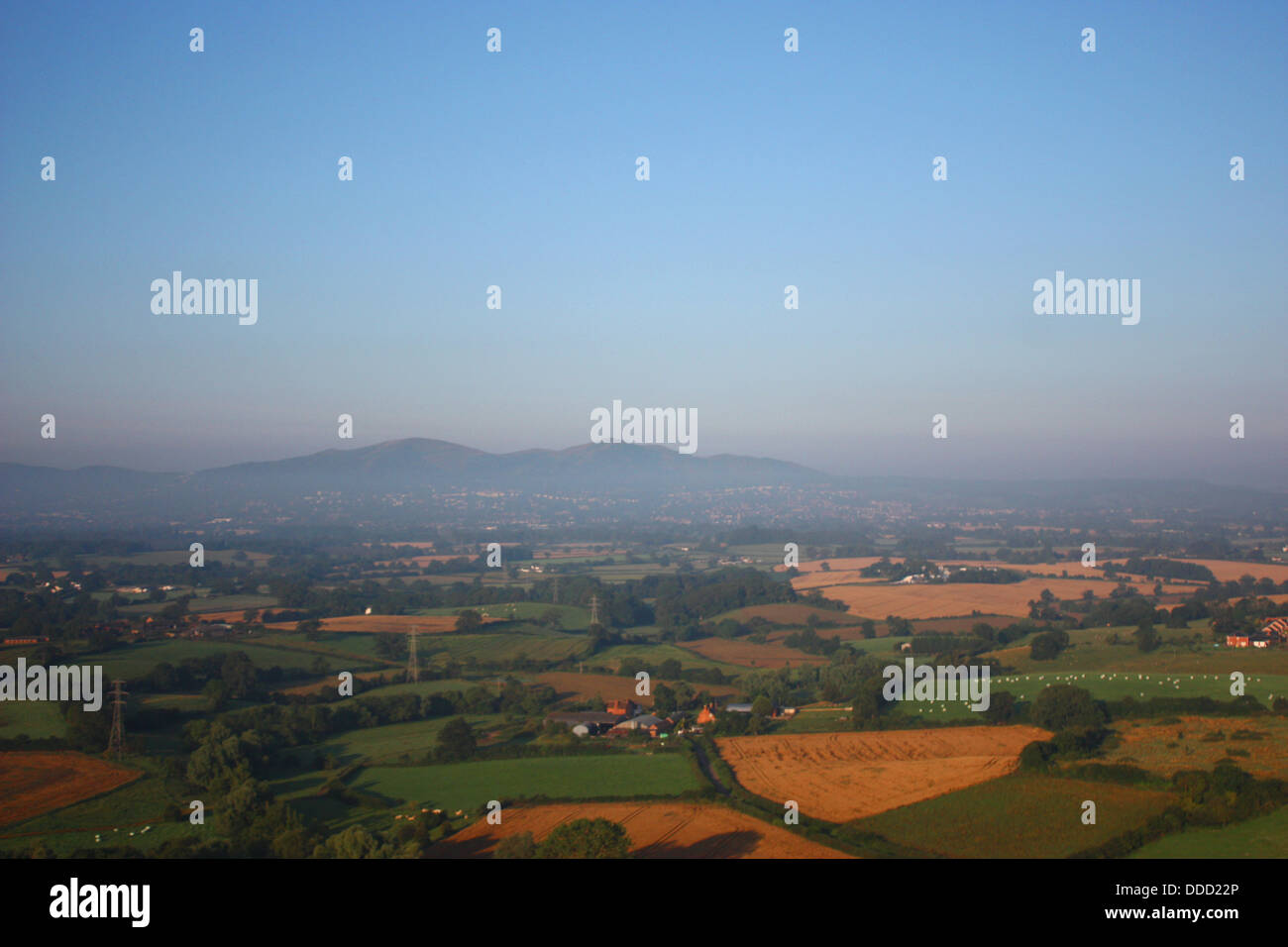 The malvern hills through mist from the air - Stock Image