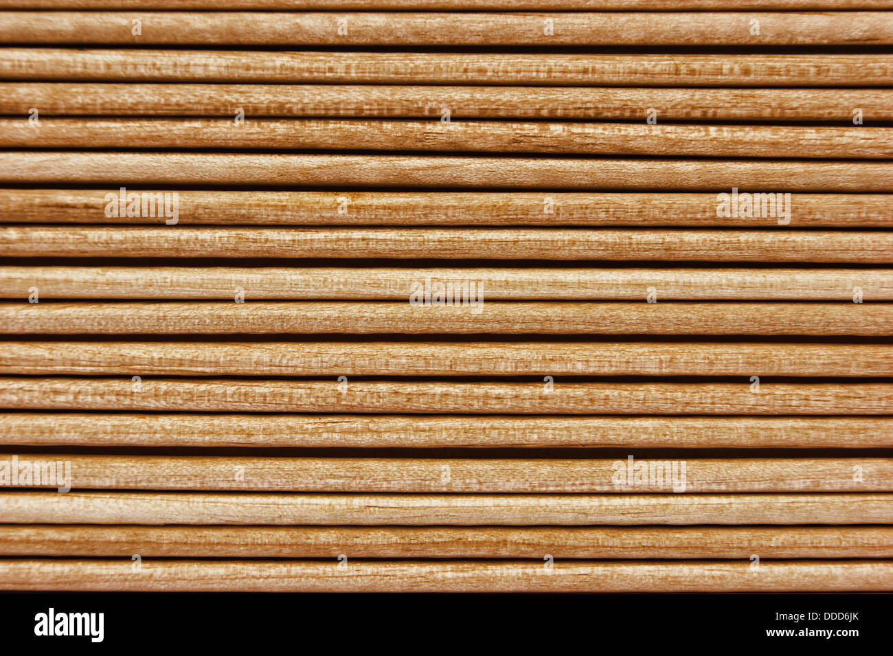 Wooden toothpicks are laid out in a number of - Stock Image