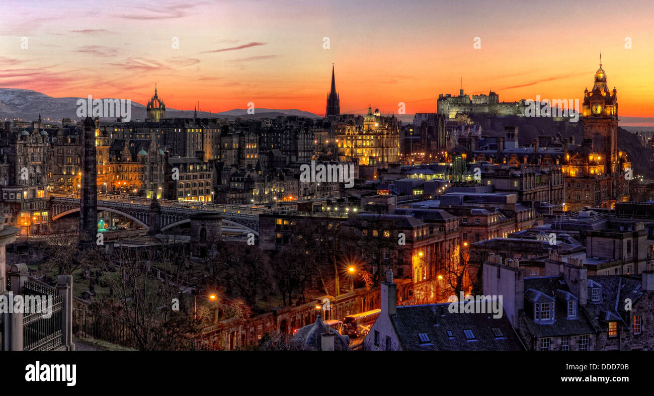 View over Edinburgh city Calton Hill at sunset showing buildings, castle, bridges and churches etc, Scotland - Stock Image