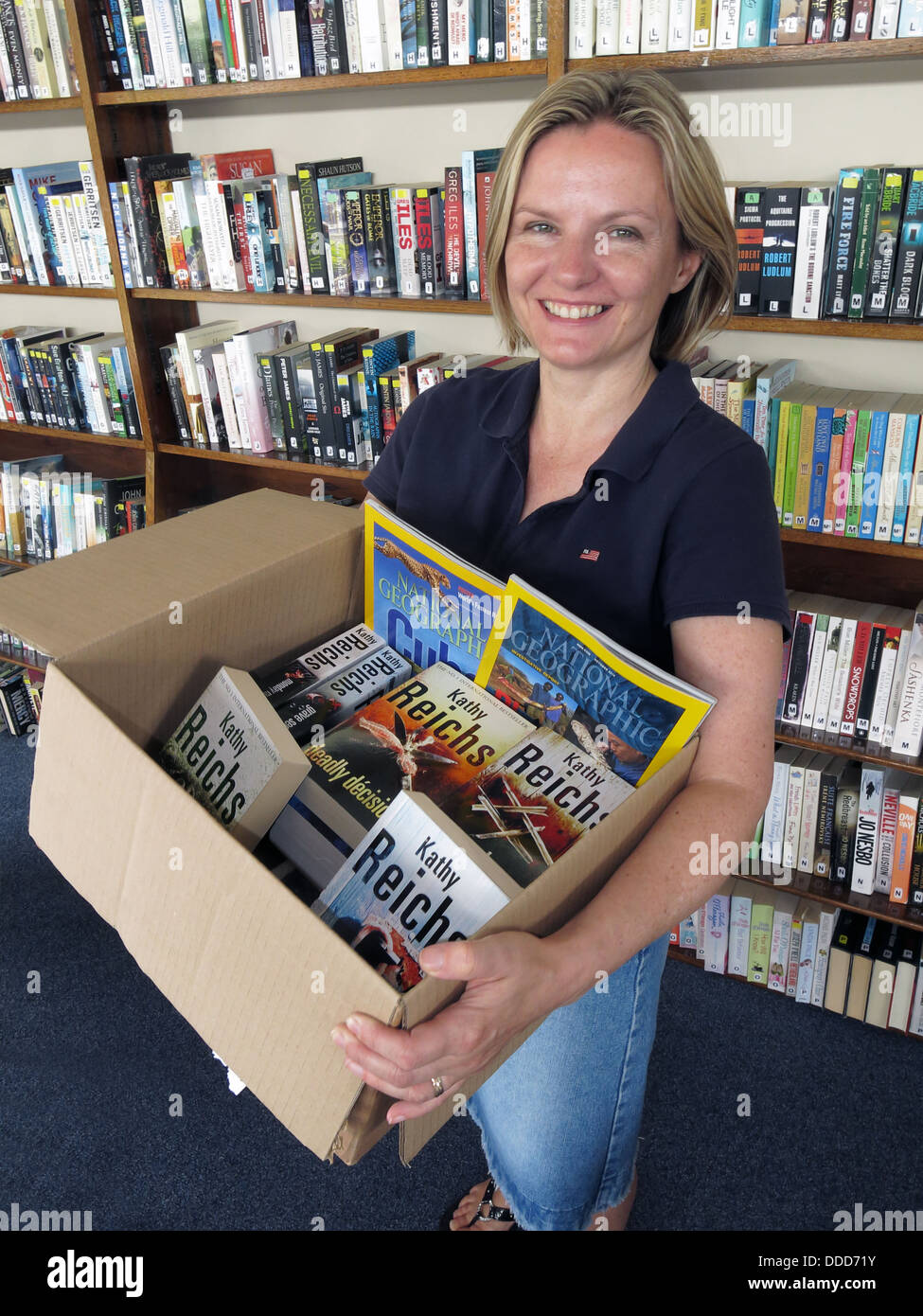 Helper at Grappenhall Community Library , Warrington, Cheshire England UK - Stock Image