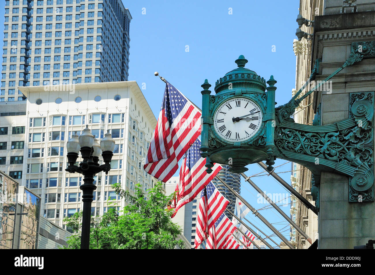 Antique clock on cornerstone of Macy's building in Chicago. - Stock Image