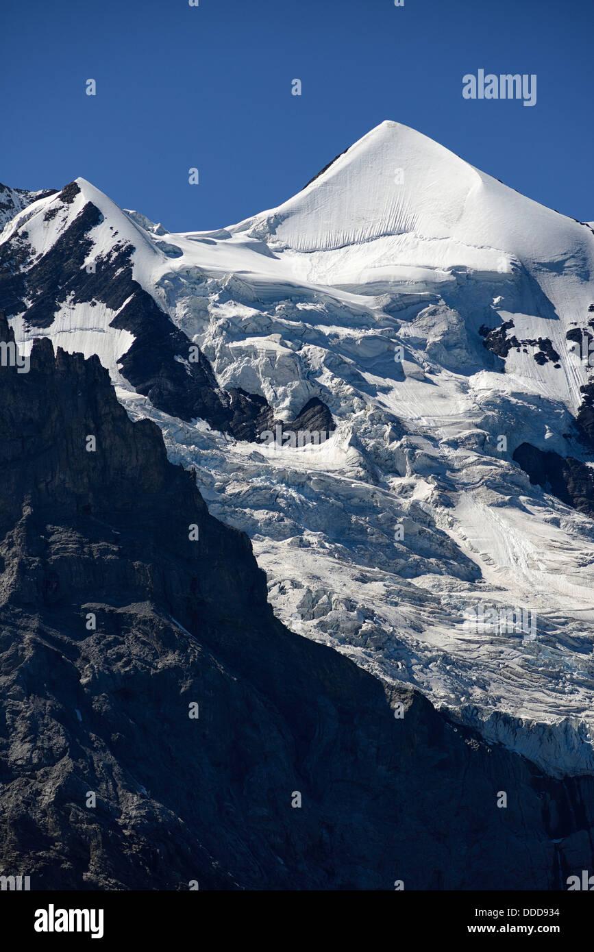 The Jungfrau, Kleine Scheidegg, mountain pass between Eiger and Lauberhorn peaks in the Bernese Oberland, Switzerland, - Stock Image