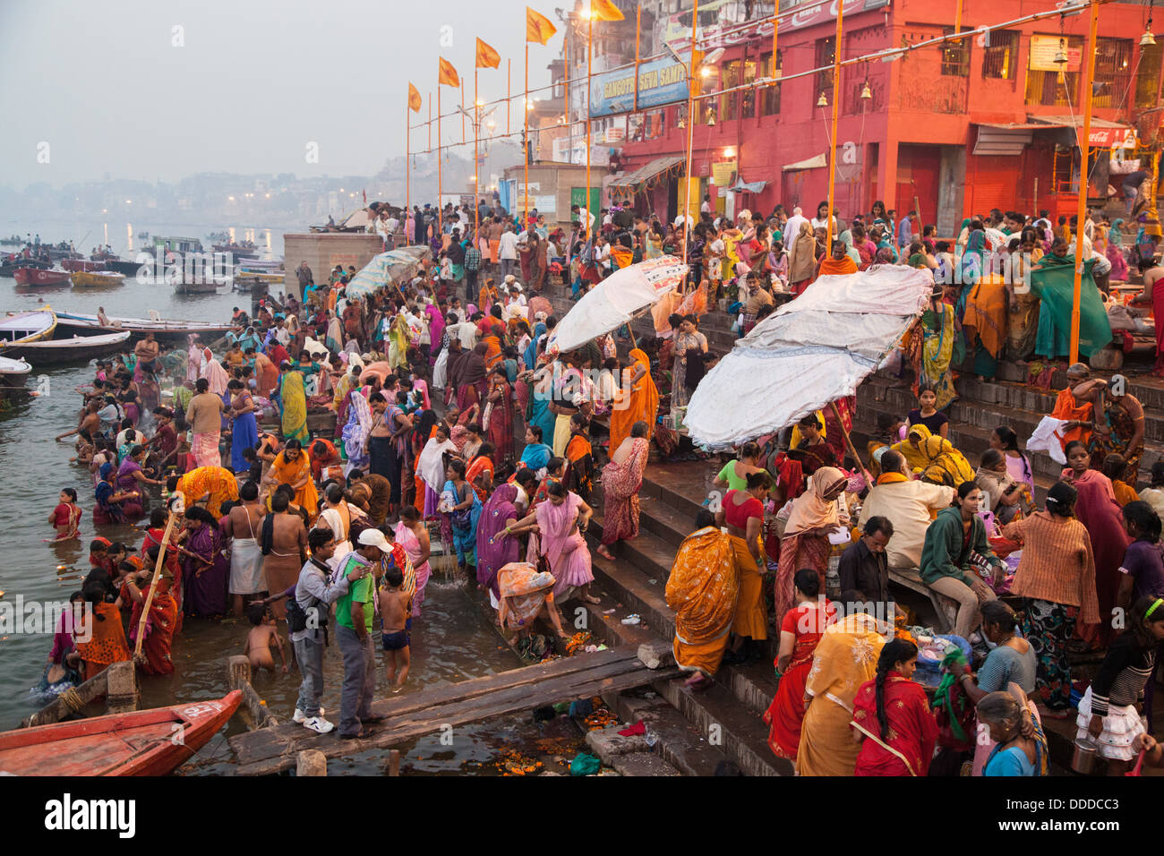 Indian Hindu pilgrims and devotees bathe in Ganges in the morning of one of Diwali festival days in Varanasi, India. - Stock Image