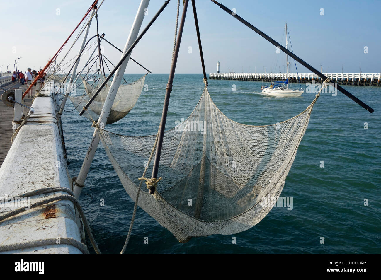 Square fishing nets bag net for rent for tourists on the for Pier fishing net