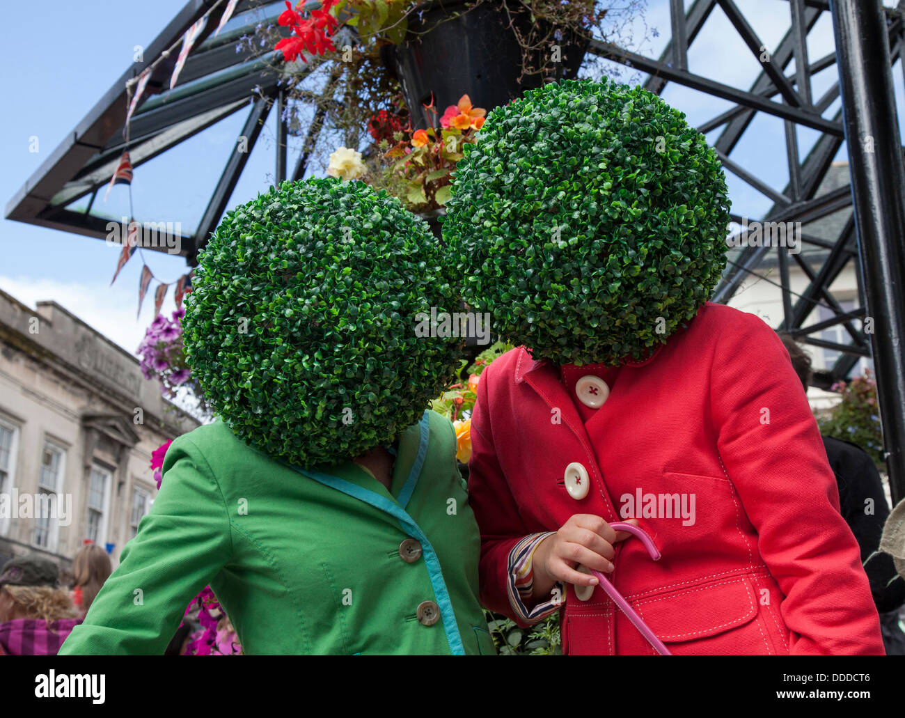 Round, circular, green head gear, topiary leafy artifical wigs, worn