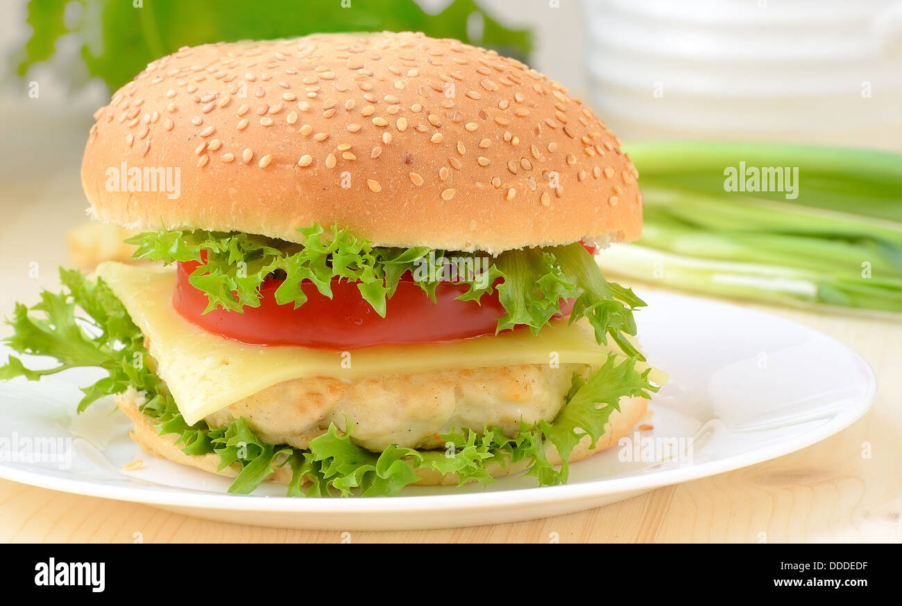 Burger fast food on white plate - Stock Image