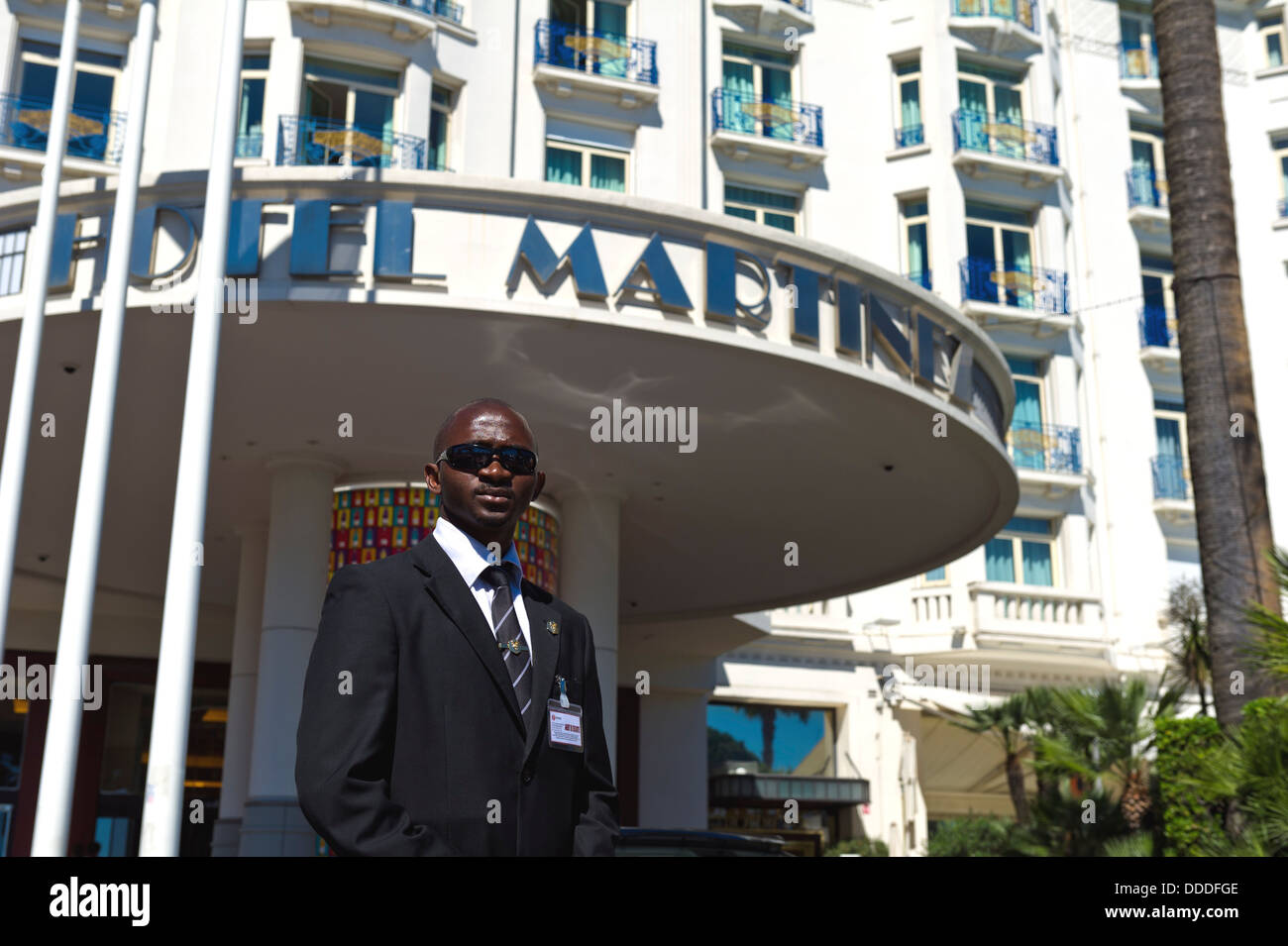 Europe, France, Alpes-Maritimes, Cannes Film Festival, a security guard at the Hotel Martinez during the film festival. - Stock Image