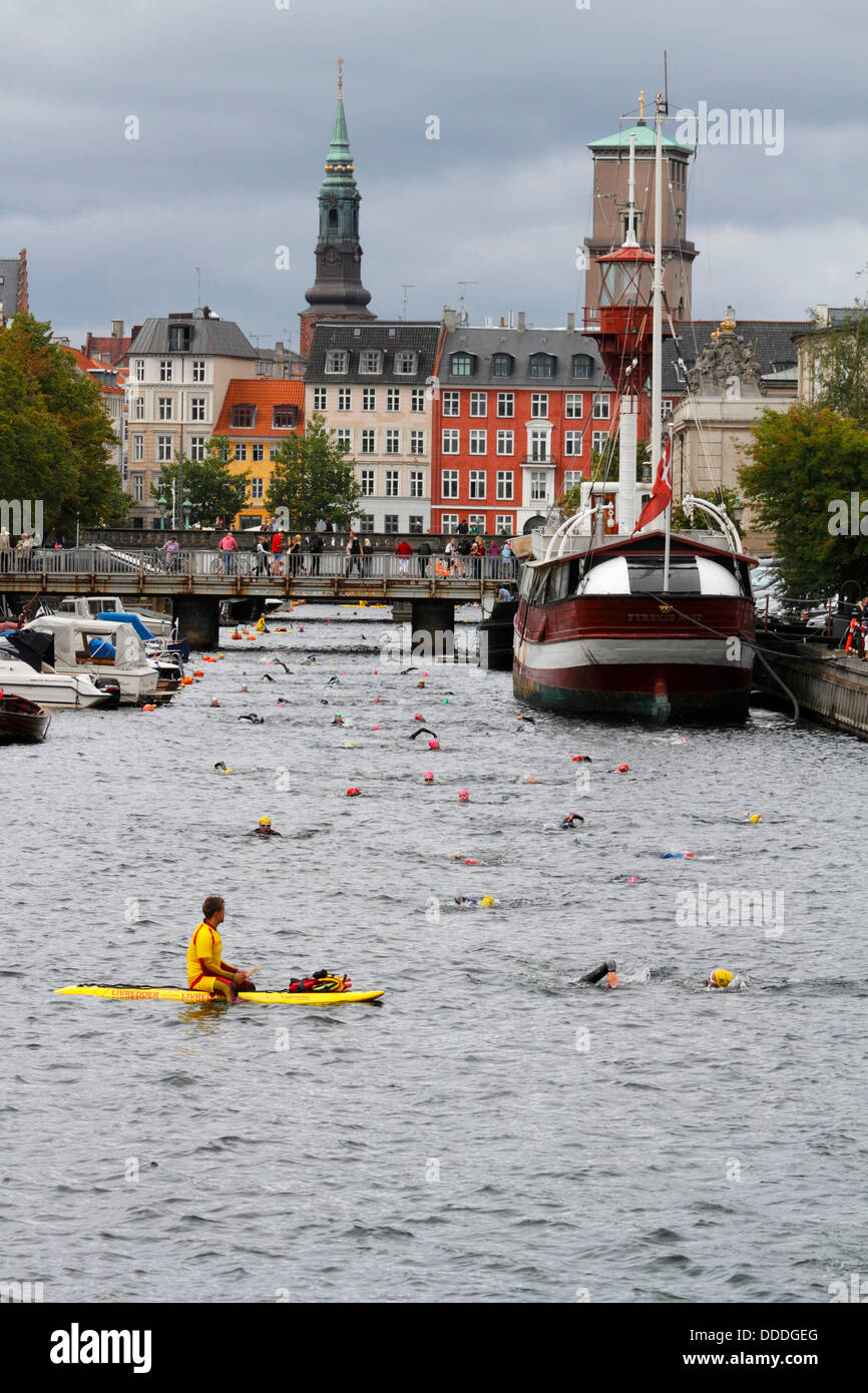 Copenhagen, Denmark. 31st Aug, 2013. 2,400 swim round the Parliament building, the Christiansborg Palace in central - Stock Image