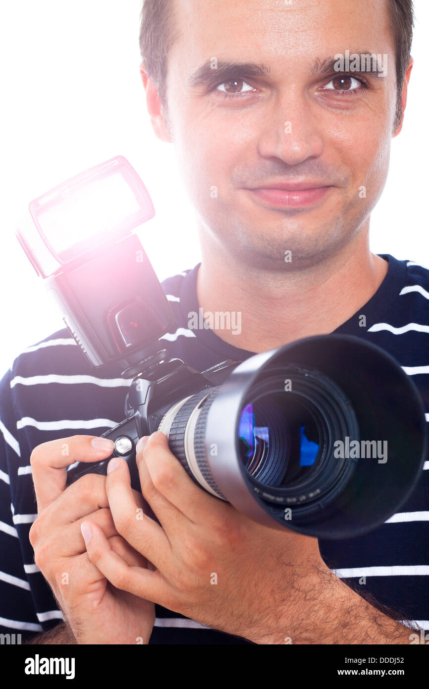 Portrait of photographer holding professional camera. - Stock Image