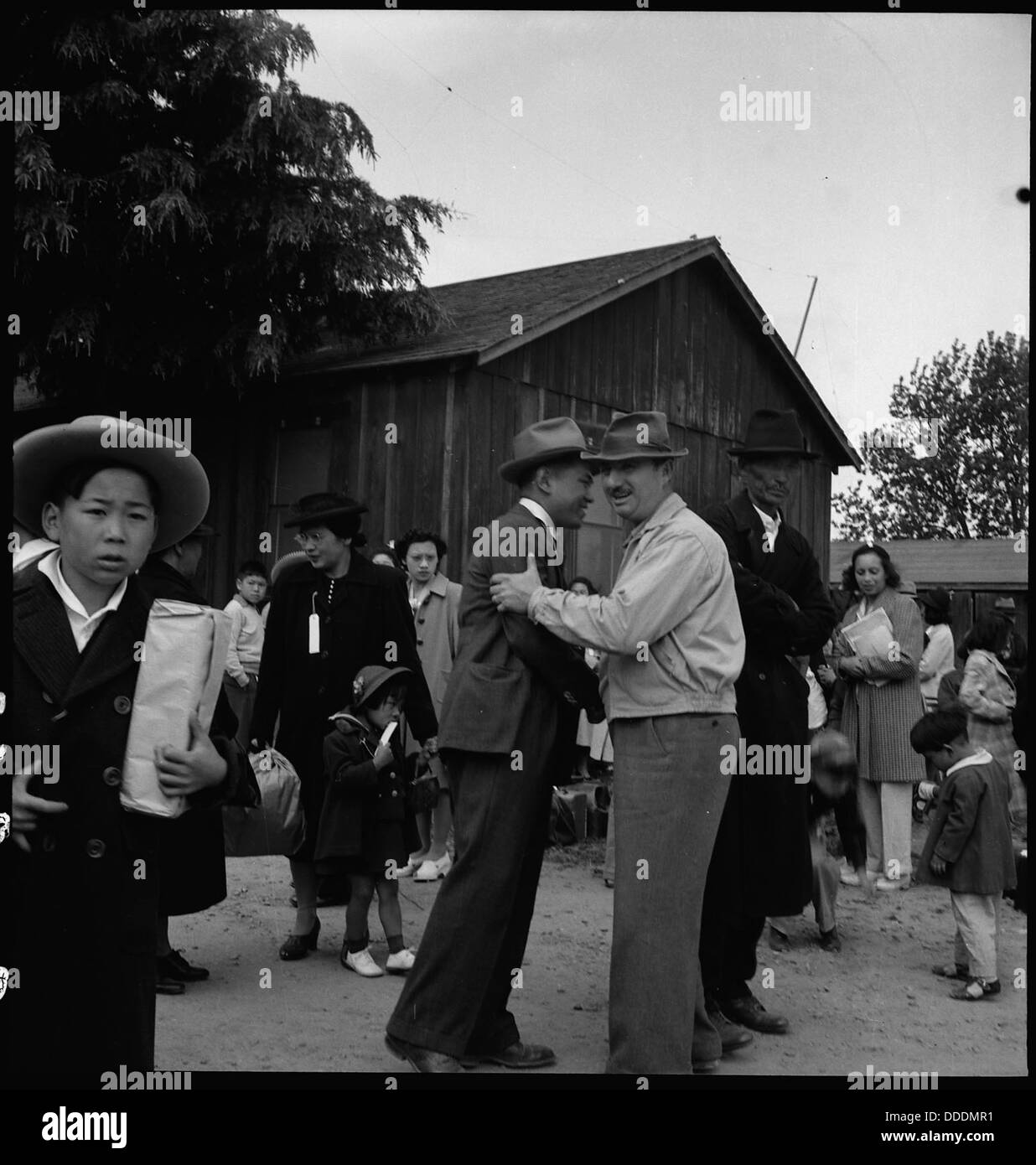 Centerville, California. A friend comes to bid a farmer of Japanese ancestry goodbye while awaiting . . . 537559 - Stock Image