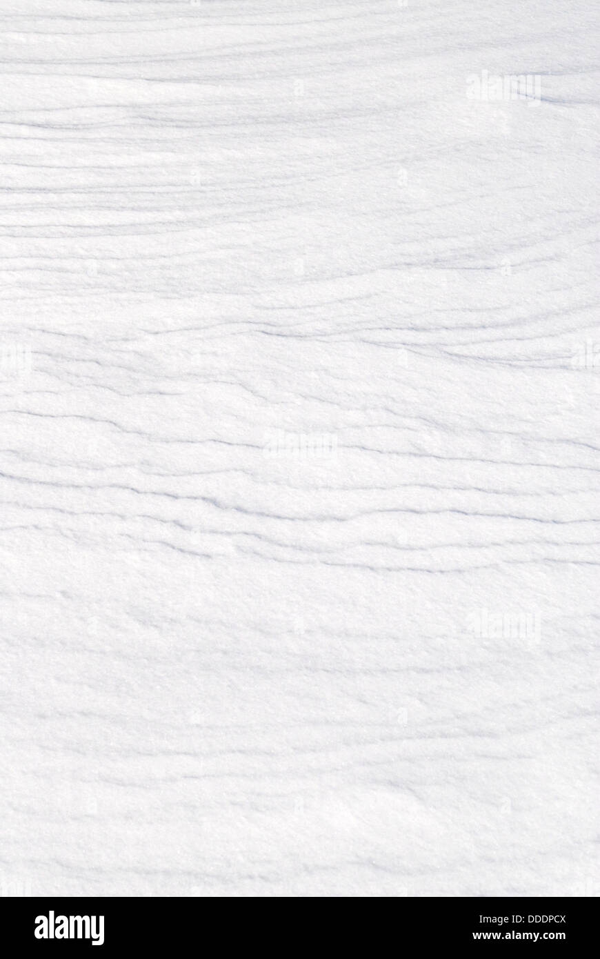 Fresh white snow background texture showing contours and layers. Stock Photo